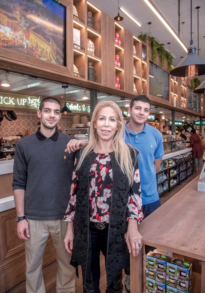 RUNNING SMOOTHLY: Greek market and café Yoleni's co-owners Alexandra Georgiou Philippides, with her sons Jimmy Philippides, right, and John Philippides. The restaurant opened on Westminster Street in downtown Providence last spring. / PBN PHOTO/MICHAEL SALERNO
