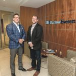 COMPETING EFFECTIVELY: DarrowEverett Chairman Zachary Darrow, left, meets with Managing Partner Joshua Berlinsky at the legal-services company's Providence office.