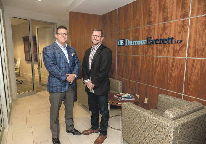 COMPETING EFFECTIVELY: DarrowEverett Chairman Zachary Darrow, left, meets with Managing Partner Joshua Berlinsky at the legal-services company's Providence office. / PBN PHOTO/MICHAEL SALERNO