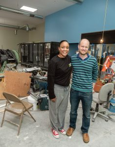 NEARING COMPLETION: Standing inside the soon-to-be Urban Greens Food Co-op grocery store on Cranston Street in Providence are Janiqua Jackson, general manager, and Philip Trevvett, vice chair, board of directors. / PBN PHOTO/MICHAEL SALERNO