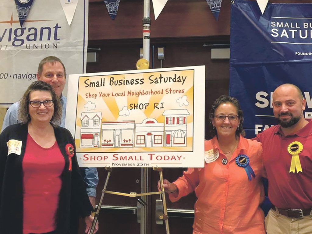 COMMUNITY SUPPORT: Small Business Saturday SHOP RI committee members, from left, Claudia Lowe, special projects coordinator; Bob Killian, co-chair and business manager; Sue Babin, co-chair and operations director; and Brian La Fauci pose for a photo during last year's Small Business Saturday event at the Crowne Plaza Providence-Warwick. This year's event will be held at the Crowne Plaza on Nov. 24.