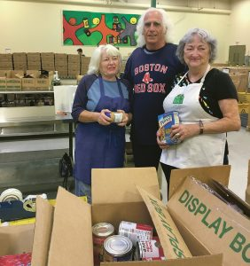 STEADFAST COMMITMENT: From left, Dorothy Villani of Cranston, Roland Cherella of North Providence and Ruth Balzano of Bristol volunteer at the Rhode Island Community Food Bank. Villani has volunteered at the food bank for 20 years, while Cherella has been a food-bank volunteer since 2009 and Balzano for the past nine years. / PBN PHOTO/EMILY GOWDEY-BACKUS