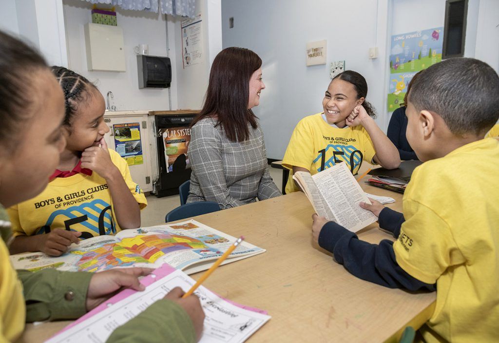 Nicole Dufresne, CEO of Boys and Girls Clubs of Providence, shares a laugh with students, from left, Lania Bonilla, 11, Jaylh Wheeler, 8, Dasia Spiver, 12, and Noah Bonilla, 7. / PBN PHOTO/MICHAEL SALERNO