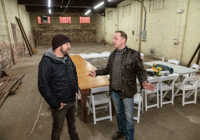 ADAPTIVE REUSE: Erik Bright, right, has recently opened, and is now leasing, an adaptive reuse building at 47 Rathbone St. in Providence, which is catering to design and artist collaborations. With Bright is neighbor Tim Ferland of The Steel Yard. / PBN PHOTO/MICHAEL SALERNO