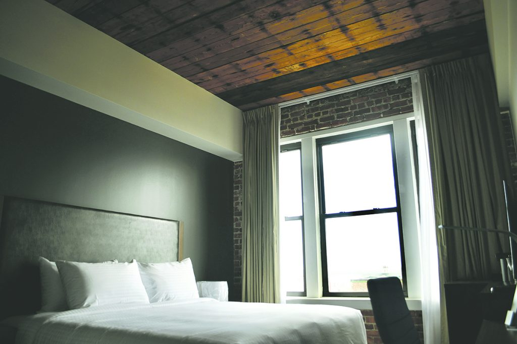 MORNING LIGHT: Each refurbished room at the New Bedford Harbor Hotel has large windows, allowing in natural light.