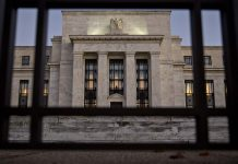 THE FEDERAL RESERVE left interest rates unchanged Thursday in a unanimous vote and stayed on course to hike in December as strong economic growth, higher tariffs and rising wages look set to spur inflation. / BLOOMBERG NEWS FILE PHOTO/ANDREW HARRER