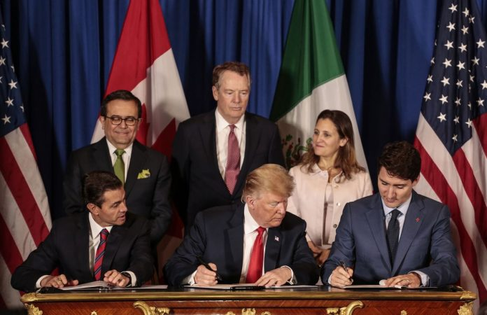 NEW AGREEMENT: Enrique Pena Nieto, Mexico's president, from front left, U.S. president Donald Trump, and Justin Trudeau, Canada's prime minister, sign the United States-Mexico-Canada Agreement (USMCA) as Ildefonso Guajardo Villarreal, Mexico's secretary of economy, from back left, Robert Lighthizer, U.S. trade representative, and Chrystia Freeland, Canada's minister of foreign affairs, stand at the G-20 Leaders' Summit in Buenos Aires, Argentina, on Friday Nov. 30, 2018. The U.S., Canada and Mexico are set to sign their new trade deal Friday following a year of intense negotiations to revamp the continent's free trade zone - after President Trump threats to kill it. BLOOMBERG NEWS FILE PHOTO/SARAH PABST