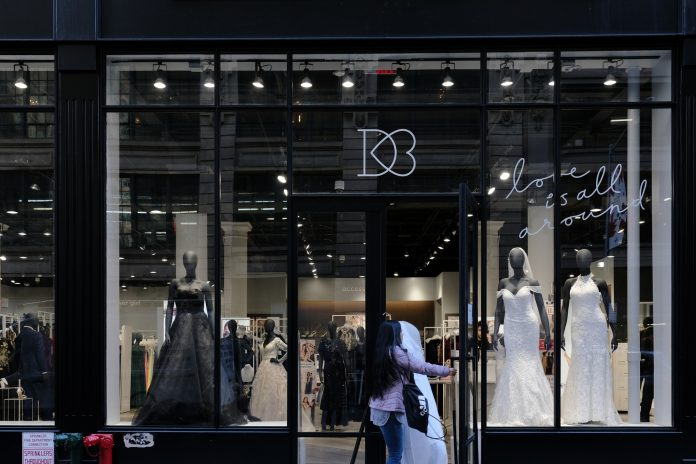 DAVID'S BRIDAL filed for Chapter 11 bankruptcy with a plan to cut debt by more than $400 million and a deal with lenders that will keep stores open during a reorganization. / BLOOMBERG NEWS FILE PHOTO/JEENAH MOON