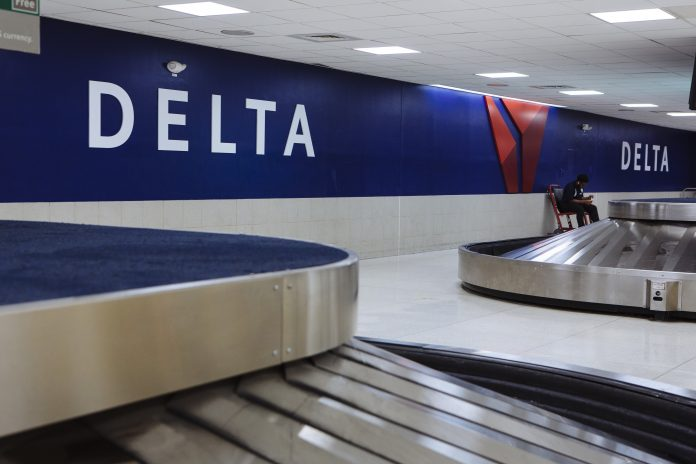 DAL GLOBAL SERVICES, a subsidiary of Delta Air Lines Inc., announced the layoffs of 51 workers in Warwick via an R.I. DLT WARN notice this month. The layoffs are anticipated to take effect Jan. 31. / BLOOMBERG NEWS FILE PHOTO/ANGUS MORDANT