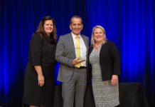 KIMBERLY GREENE (left), chairman of the board of the Providence Warwick Convention & Visitors Bureau and Martha Sheridan, PWCVB president and CEO, congratulate Larry Lepore, general manager of the Dunkin' Donuts Center and the RI Convention Center. Lepore was inducted into the PWCVB's Hall of Fame at its annual meeting. / COURTESY PROVIDENCE WARWICK CONVENTION AND VISITORS BUREAU