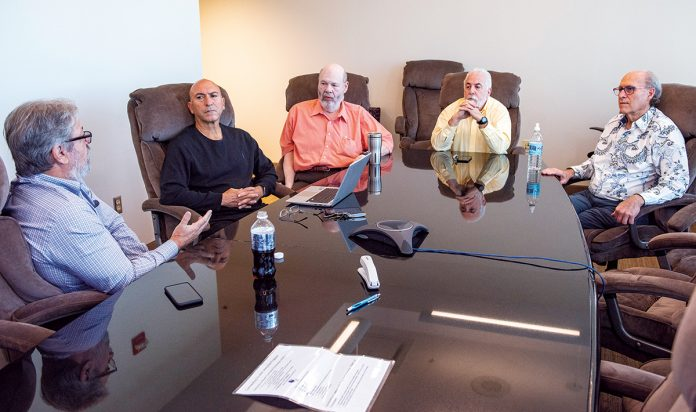 FAMILY MEETING: Marc Perlman, left, speaks during a recent Ocean State Job Lot owners meeting at the company's North Kingstown headquarters. Also attending are, from left, John Conforti, Richard Portno, Alan Perlman and Steve Aronow.