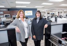DILIGENT DUO: From left, sisters Gail Almeida Parella and Lisa Almeida Sienkiewicz in their store, Gil's Appliances in Bristol. The two have worked to modernize the store and make it an integral part of the community.  / PBN PHOTO/KATE WHITNEY LUCEY