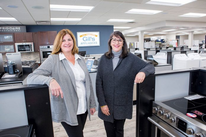 DILIGENT DUO: From left, sisters Gail Almeida Parella and Lisa Almeida Sienkiewicz in their store, Gil's Appliances in Bristol. The two have worked to modernize the store and make it an integral part of the community. 