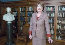 DYNAMIC DIRECTION: Christina H. Paxson, president of Brown University, in the Bruhn Room in the university's John Hay Library. / PBN PHOTO/RUPERT WHITELEY