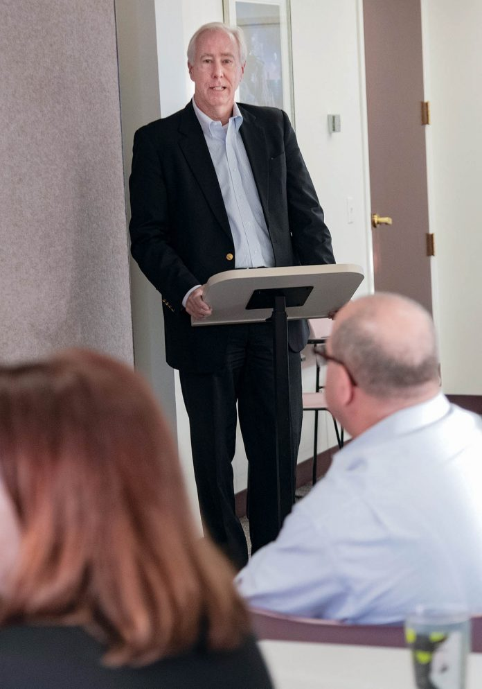 team culture: Starkweather & Shepley Insurance Brokerage CEO Larry Keefe speaks to sales staff during a morning meeting at the company's East Providence office.  / PBN PHOTO/MICHAEL SALERNO