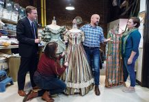 """A RICH, AND NOW PROSPEROUS HISTORY: From left, Tom Parrish, executive director; Meg Donnelly, cutter/draper; Curt Columbus, artistic director; and Amanda Downing Carney, costume shop director, review costumes for the upcoming production of """"A Christmas Carol.""""    / PBN PHOTO/RUPERT WHITELeY"""