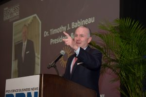 LIFESPAN PRESIDENT AND CEO Dr. Timothy J. Babineau gestures during his remarks to the PBN Business Excellence Awards program attendees Wednesday at the Omni Hotel Providence. He was recognized for Corporate Citizenship. / PBN PHOTO/MIKE SKORSKI