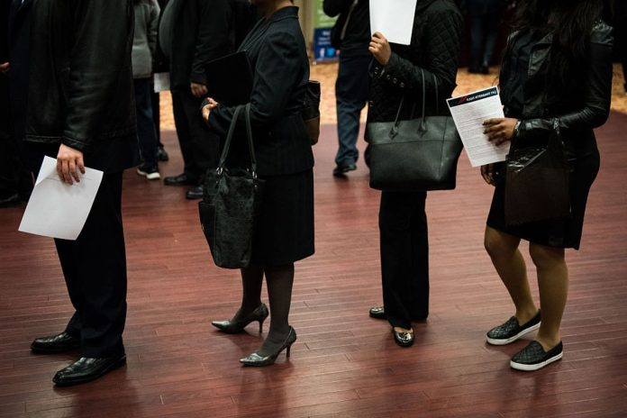 UNITED STATES jobless claims declined by 1,000 to 216,000 last week . /BLOOMBERG NEWS FILE PHOTO/MARK KAUZLARICH