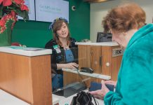 ASSISTING CUSTOMERS: Bank teller Kayla Beauvais, left, helps Jacqueline Daigneault of Cumberland at the Citizens Bank branch in town at 2000 Mendon Road. / PBN PHOTO/MICHAEL SALERNO