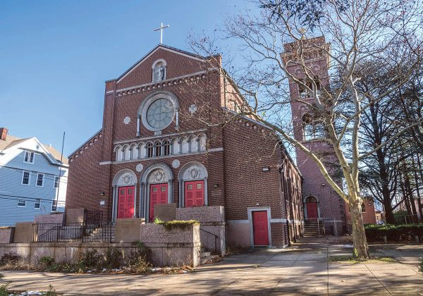 ON THE MARKET: Our Lady of Mt. Carmel Church in Providence, which is now closed, has been proposed for redevelopment by The Omni Group into mixed-use. The church is one of two properties still owned by the Diocese of Providence. / PBN PHOTO/MICHAEL SALERNO