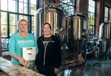 NEW PATH: Co-owners Kris Waugh, left, and Tamara McKenney worked in technical recruiting before opening Apponaug Brewing at the Pontiac Mills in Warwick. / PBN PHOTO/MICHAEL SALERNO