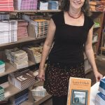 FRESH START: Anne Wolfe is the owner of Bear Wallow Books in Providence. The company had been owned by her parents in Indiana but after the death of her father, Wolfe bought her mother out of the company and moved it to Providence. / PBN PHOTO/MICHAEL SALERNO