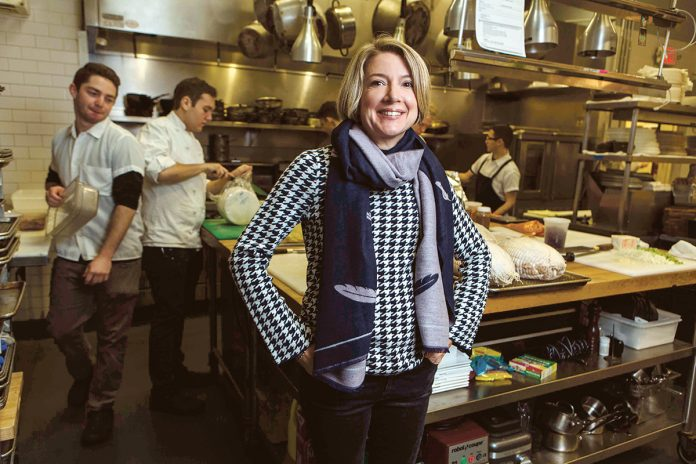 LOCAL FLAVOR: Gracie's is taking part in the summer Providence Restaurant Weeks, July 7-20. Owner Ellen Slattery with, background from left, kitchen staff Jordan Fleischer, Brian O'Connell, Andres Rodriguez and Josh Berman, in the restaurant's Washington Street location in Providence. 