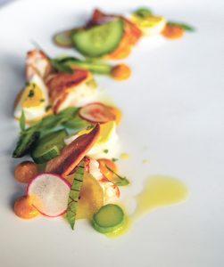 POINT JUDITH LOBSTER: Point Judith lobster, with asparagus, chili mayo, marinated cucumber, radish and quail egg. / COURTESY GRACIE'S VENTURES INC.