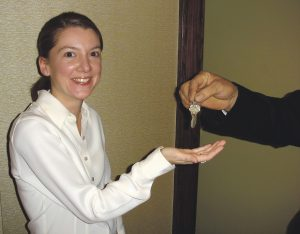 NEW LOCATION: Gracie's Ventures owner Ellen Slattery receives the key to the front door of the restaurant from then-Providence Mayor David N. Cicilline. Gracie's opened on Washington Street in May 2005 after moving from its Federal Hill location.  / COURTESY GRACIE'S VENTURES