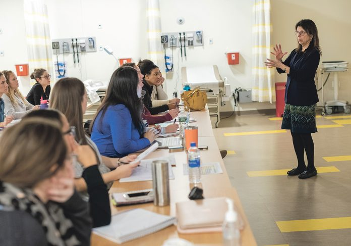 ENGAGING STUDENTS: Denise Coppa, interim associate dean of graduate programs at the University of Rhode Island's College of Nursing, teaches a class at the Rhode Island Nursing Education Center in Providence. / PBN PHOTO/MICHAEL SALERNO