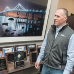ENERGIZED: Tim Blanchard, right, CEO of Energy Source, a Providence-based company that does energy-efficiency projects for businesses in Rhode Island, Massachusetts and beyond, speaks with Dalton Ling, energy-efficiency consultant. / PBN PHOTO/MICHAEL SALERNO