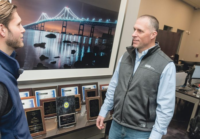 ENERGIZED: Tim Blanchard, right, CEO of Energy Source, a Providence-based company that does energy-efficiency projects for businesses in Rhode Island, Massachusetts and beyond, speaks with Dalton Ling, energy-efficiency ­consultant.