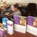 INCREASED ENROLLMENT: Aaliyah Perez is a customer service representative at HealthSource RI's Walk-in Center in East Providence. The state's health exchange had enrolled 31,771 people for health care insurance as of Dec. 10, 11 percent higher than on the same date in 2017.