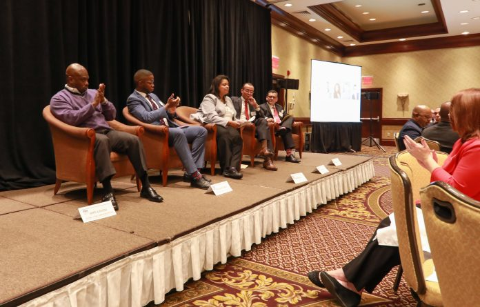 PANELSTS AT PBN's Diversity & Inclusion Summit address attendees at the Crowne Plaza Providence-Warwick. From left to right, Greg Almieda, Guillaume Bagal, Kim Barker Lee, Juan Lopera and Randy Martinez. / PBN PHOTO/ PAMELA BHATIA