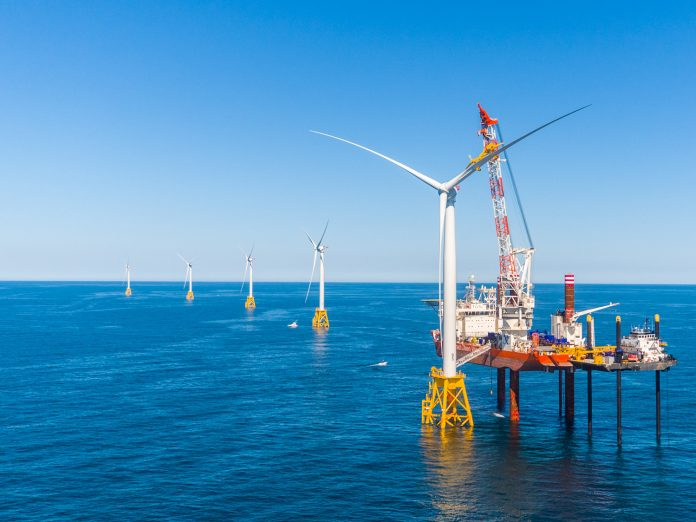 OFFSHORE WIND DEVELOPMENT lease rights for 390,000 acres of federal tracts south of Martha's Vineyard was auctioned for a record $405 million. Above the Block Island Wind Farm. / COURTESY DEEPWATER WIND
