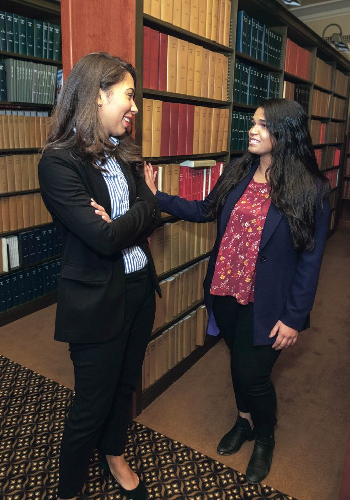 JUDICIOUS EXPERIENCE: Dorca M. Paulino, left, diversity director at the R.I. judiciary, talks with her recent recruit, University of Rhode Island graduate Sharon Santiago. / PBN PHOTO/MICHAEL SALERNO