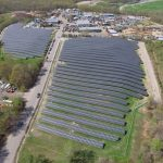 AN AERIAL VIEW shows more than 9,000 solar panels clustered to form the A Street solar energy farm, located at a former landfill in Johnston. The facility will be used to generate power for Johnston and Providence. / COURTESY SOUTHERN SKY RENEWABLE ENERGY RI