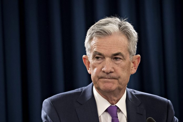 THE FEDERAL RESERVE, led by Chairman Jerome Powell, raised the federal funds rate target to a range of 2.25 percent to 2.5 percent, the central bank's fourth hike this year. But Powell and company signaled that they expect two rate hikes in 2019, as opposed to the three that were forecast previously. / BLOOMBERG NEWS FILE PHOTO/ANDREW HARRER
