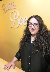 ALTERNATIVE SOAPS: Bianca Alicea, above, is the owner of Bubble Bee Soapery, on Atwells Avenue in Providence, which is aimed at people who want a chemical-free alternative to body and bath products.  / PBN PHOTO/MICHAEL SALERNO