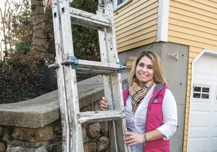 ADAPT TO SURVIVE: Ilana Ball, owner and president of Total Asset Solutions in Woonsocket, adapted her business selling homes and condos into property management and maintenance after her potential sales turned to rentals when the Great Recession hit in 2008. / PBN PHOTO/MICHAEL SALERNO