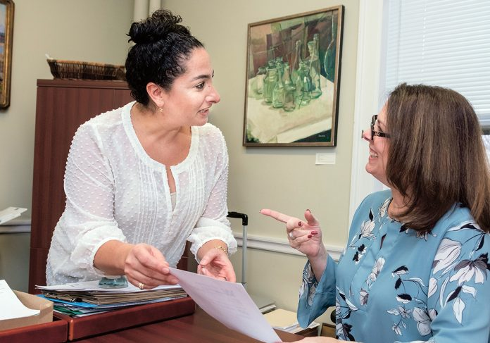 NEW CONSORTIUM: Touba Ghadessi, left, co-founder of the Wheaton Institute for Interdisciplinary Humanities, speaks with Alison Ricco, administrative associate office of the provost. Ghadessi hopes to encourage more students to pursue the humanities as a career path by partnering with 10 other New England-based higher education institutions with humanities centers to form the New England Humanities Consortium./PBN PHOTO/