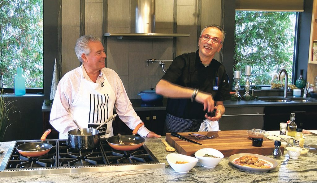 """COOKING WORKSHOP: Master chef Walter Potenza, right, and Steve Cascione film an episode of the """"Flavors of Knowledge"""" TV show in the Rhode Island Kitchen and Bath showroom at 139 Jefferson Blvd. in Warwick. Potenza will launch a cooking workshop series at the location in February. / COURTESY OF """"FLAVORS OF KNOWLEDGE"""""""