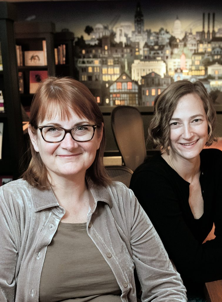 GATHERING PLACE: Anne Holland, left, founder of the What Cheer Writer's Club, with Jodie Vinson, program manager. Holland started the club because she wanted a place where local writers of all sorts could work, network and collaborate.