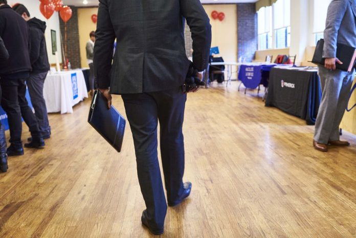 THE NONSEASONALLY adjusted unemployment rate in the Providence metro area declined 0.4 percentage points year over year to 3.7 percent in December. / BLOOMBERG NEWS FILE PHOTO/GABBY JONES