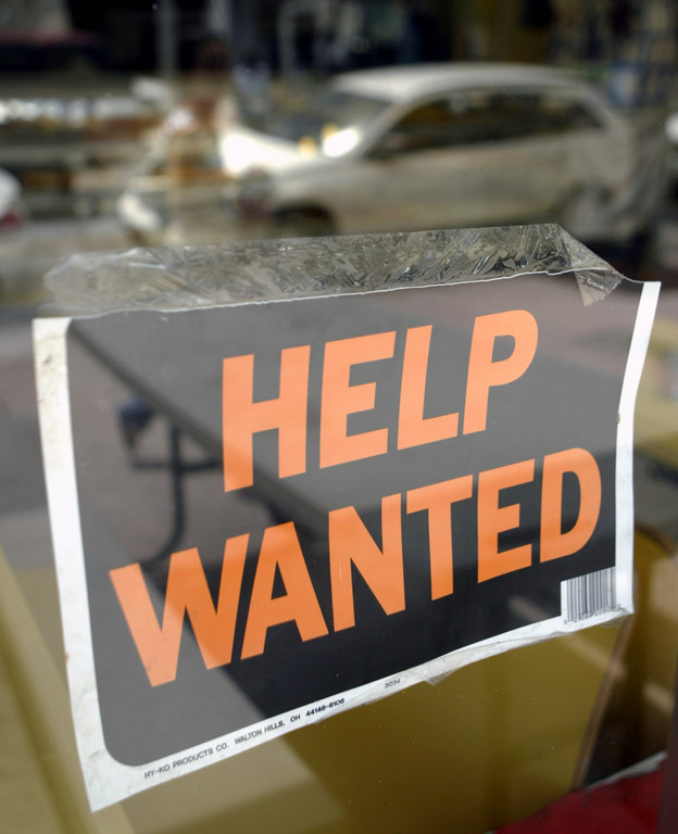 U.S JOB OPENINGS decreased by 243,000 to 6.89 million in November. / BLOOMBERG NEWS FILE PHOTO/MIKE FUENTES