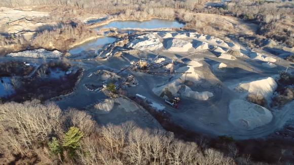 A FORMER SAND AND GRAVEL MINING SITE IN NORTH KINGSTOWN will be transformed into 240 acres of solar arrays that will provide 40 megawatts of energy to Rhode Island's electrical grid. Brown University will use the energy to offset 70 percent of its annual fossil fuel consumption on campus. / COURTESY BROWN UNIVERSITY/STEPHEN CROCKER /