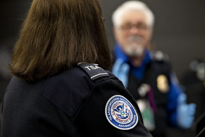 TRANSPORTATION SECURITY ADMINISTRATION agents work at a check point inside O'Hare International Airport in Chicago recently. With screeners calling in sick in larger-than-normal numbers, U.S. airports have been experiencing disruptions. / BLOOMBERG NEWS PHOTO/DANIEL ACKER
