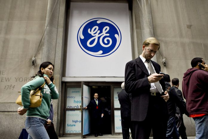 GENERAL ELECTRIC STOCK jumped the most in almost a decade as the new CEO Larry Culp detailed his efforts to reduce the company's debilitating debt load, fix the ailing power business and ease lingering uncertainties weighing on the shares. The company also announced a deal to settle a Justice Department probe into its defunct subprime-mortgage unit for less than investors had feared. / BLOOMBERG NEWS FILE PHOTO/DANIEL ACKER
