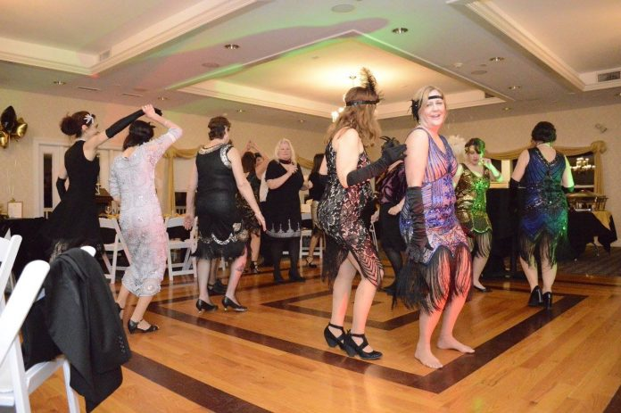 ATTENDEES DANCE during last year's Busy Buddies Foundation's Roaring '20s gala. This year's event will take place on Feb. 9 at Laurel Lane Country Club in South Kingstown. / COURTESY BUSY BUDDIES FOUNDATION