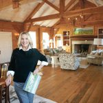 RARE PROPERTY: Mary Philbin, an agent with Mott & Chace Sotheby's International Realty, stands in the great room of a 3,600-square-foot, single-level, clapboard home set on 15 acres, abutted by conservancy land, in the Matunuck village of South Kingstown.   / PBN PHOTO/DAVID HANSEN